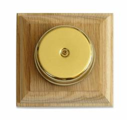 Wired Wall Mounted Underdome Brass Doorbell on a Natural Unv